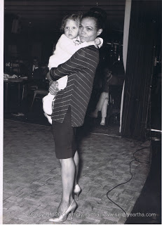 Eartha Kitt holding her young daughter Kitt