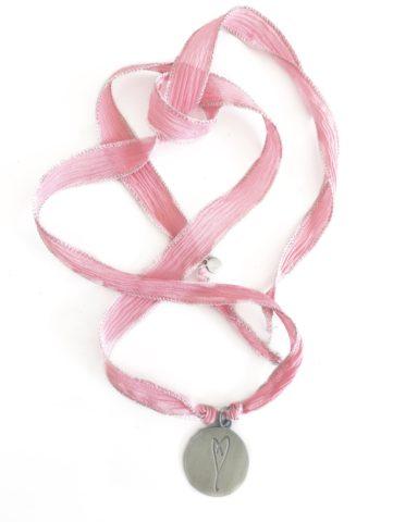 Eartha Kitt's handdrawn heart pink ribbon wrap bracelet
