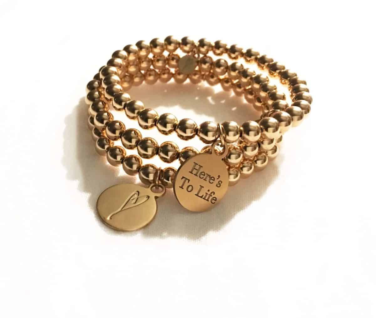 Simply eartha gold bead bracelet with heart charm